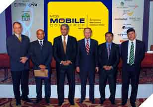 Mr. Imran Qurashi (President Access Group), Mr. Hannes Van Rensburg (CEO Fundamo) & Mr. Faisal Rahem (Total Combination) with Attendees at the 3rd international Mobile Commerce Conference.